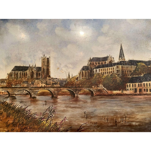 This hand painted porcelain plaque was created in France circa 1870. The composition depicts the city of Auxerre, which is...