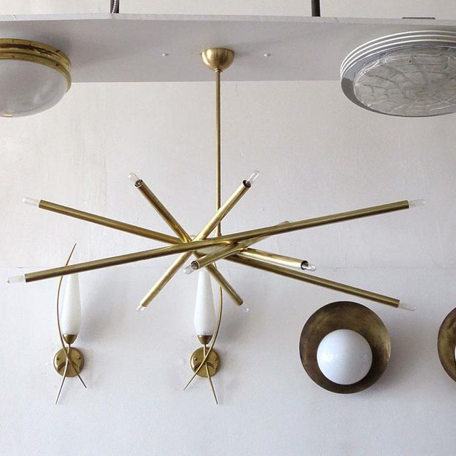"""Stunning oval 6-arm, twelve light chandelier in raw brass by Gallery L7, diameter: 42""""x24"""", made to order with a 2-4 week..."""