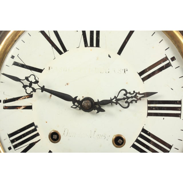 This 19th-century French Napoleon III wall clock features an ebonized wood frame, tesselated abalone inlay, and clock face...