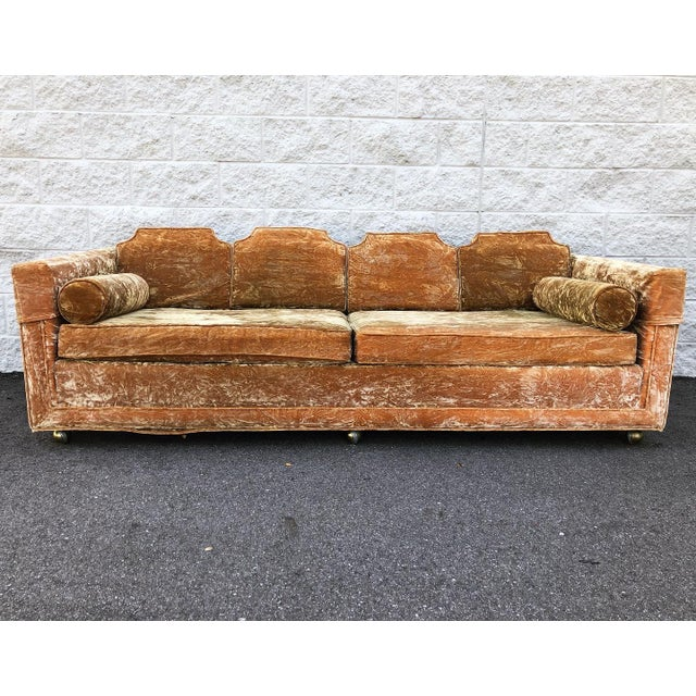 Mid Century Gold Crushed Velvet Sofa in like new condition. Sofa sits on casters that roll smoothly. Comes with four back...