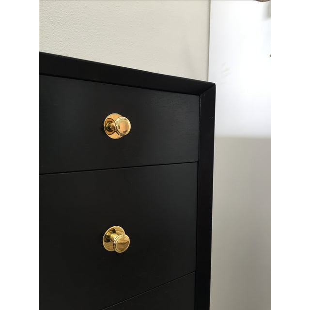 Stunning five-drawer black dresser in the style of Paul Frankl or Tommy Parzinger. Solid brass hardware has been polished...