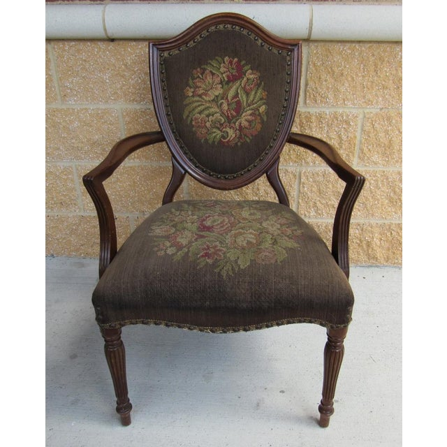 Vintage, pre 1950, Louis XV upholstered side chair with an upholstered shield back and channeled wood armrests Features...