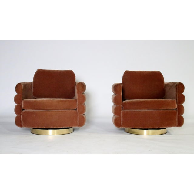 Very rare pair of Milo Baughman swivel chairs for Thayer Coggin from the late 1970's to early 1980's. These noteworthy...