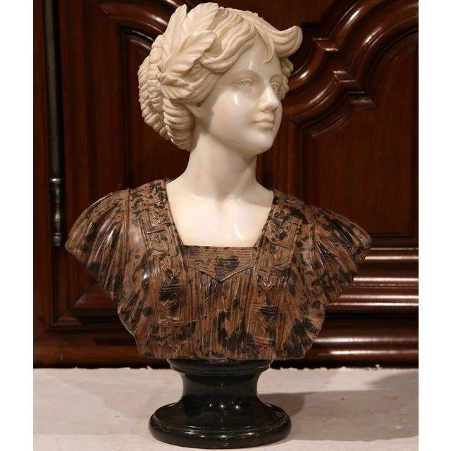 Bring the charisma of Italy into your home with this beautiful two-tone antique marble bust from Italy, circa 1895. This...