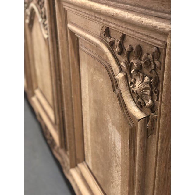 Early 20th C. French regency stripped marble top enfilade in oak. Cabriole feet. Hand carved doors and paneling. Solid peg...