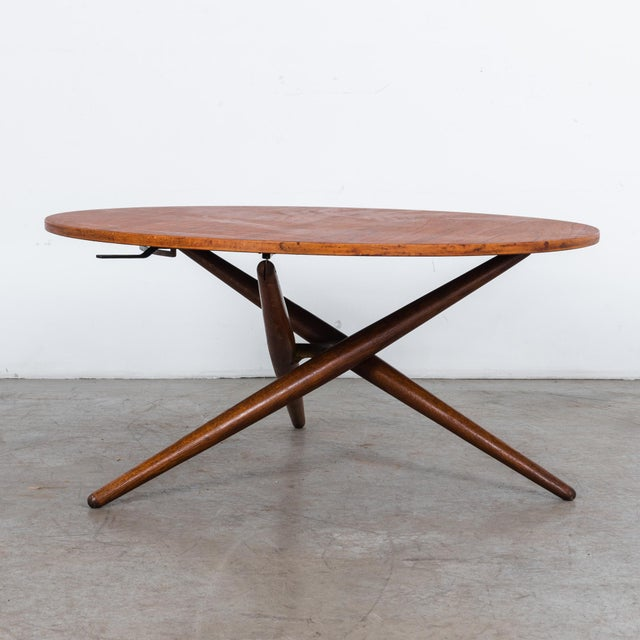 Round adjustable oak wood table with veneered top, by designer Jurg Bally, circa 1960. This acclaimed design features a...