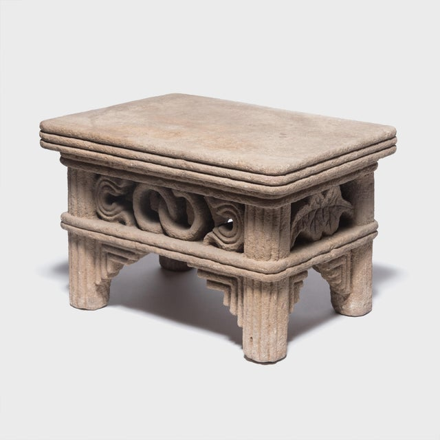 This table was carved by hand over 400 years ago in China's Hubei Province out of a single block of limestone. Its carved...