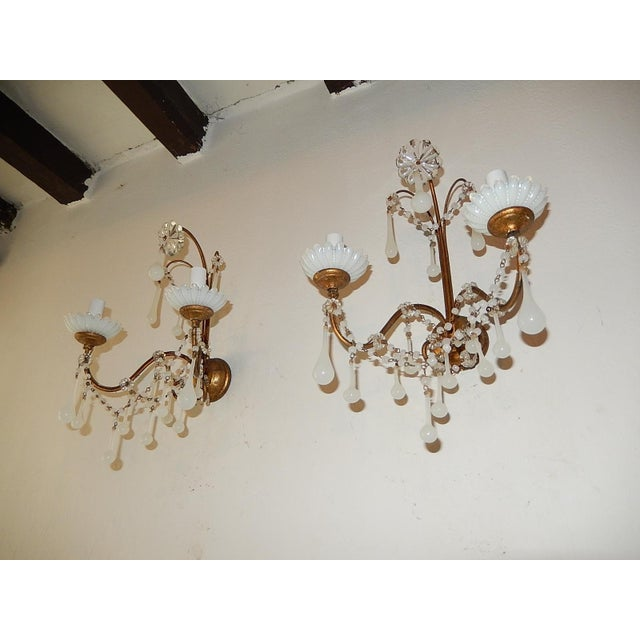 Housing two lights each. Rewired and ready to hang. White opaline bobeches, drops and swags of beads. Giltwood posts and...