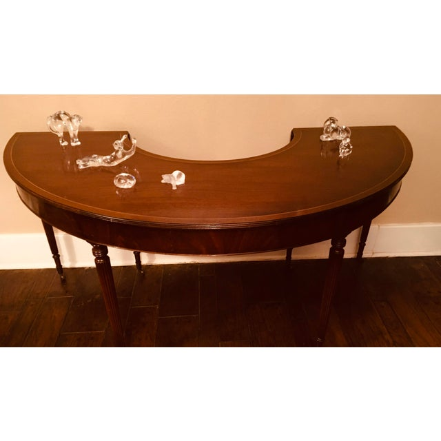 Elegant solid mahogany Hunt table in the Federal regency style with central drawer. These tables were commonly used in...