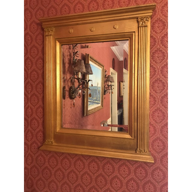 This classic yet stunning rectangular mirror in burnished gilt gold leaf features carved fluted columns and raised...