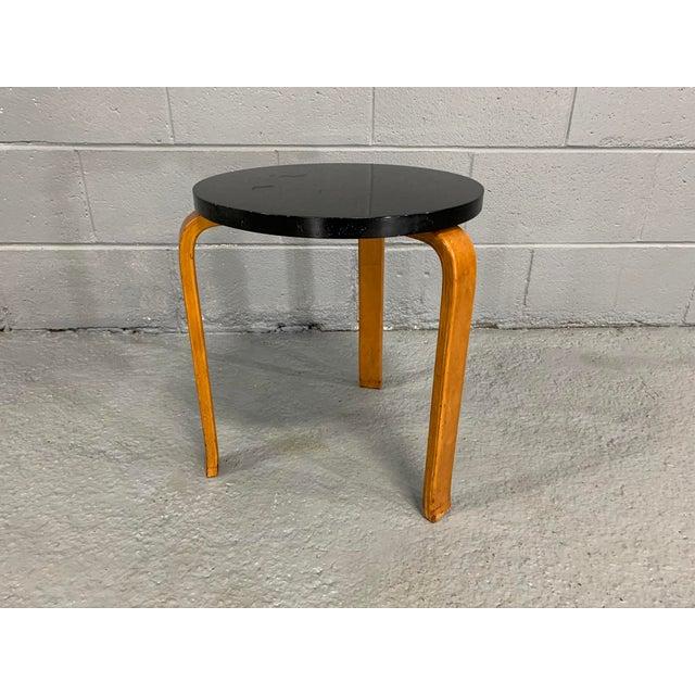 Alvar Aalto stool manufactured by Artek, originally designed in 1933. Crafted in Laminated Birch. Retails warm, rich,...