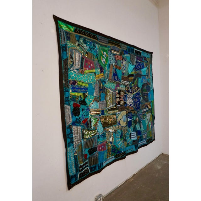 """Bright colorful wall hanging with patchwork fabric,sequins,embroidery, and beads. Measures 77"""" x 93""""and has black cotton..."""