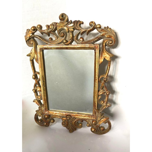 Beautiful Vintage Baroque Style Gold Gilt Carved Mirror with Stunning Ornate Details. The frame is in excellent condition.