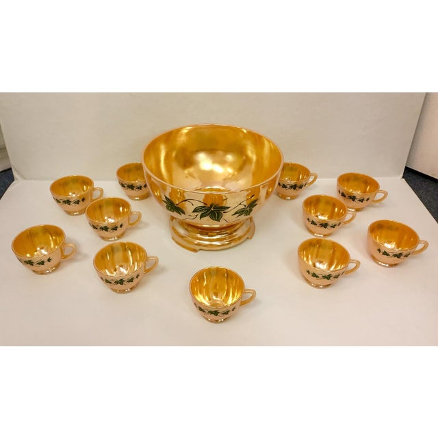 Beautiful peach luster set of one punch bowl with stand and eleven handled cups. Iridescent interior of each piece, and...