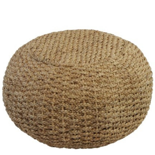 Elegant yet sturdy, this pouf brings a touch of texture and handy extra seat or surface to any space.
