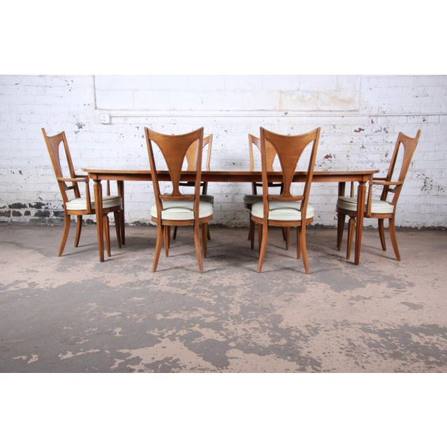 """A gorgeous mid-century modern dining set from the """"Caravan"""" collection by Romweber. The set includes the extension dining..."""