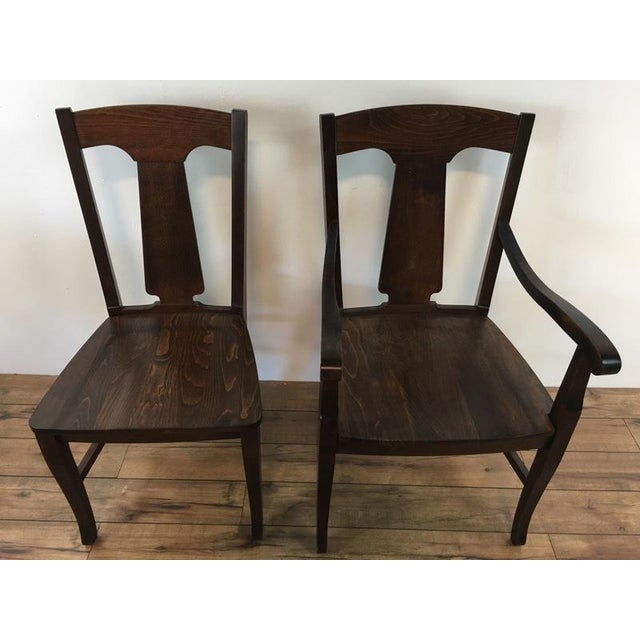 Dress up your dining table with four stunning Dining Chairs from Pottery Barn. This set of four contemporary chairs...