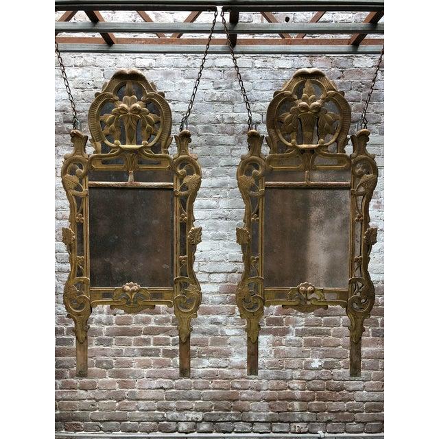 A triptych of three Louis XV mirrors , mid-18th Century,provincial. Exceptional set! circa 1765 All three Louis XV gilt...