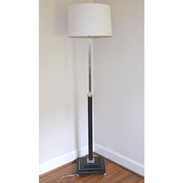 French large-scale modern chrome-plated and newer ebonized lacquered finish wood floor lamp in the manner of Parzinger....