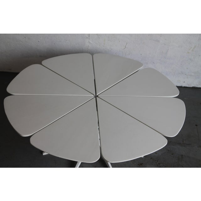 Iconic petal table designed by Richard Schullz for Knoll from 1960-1974. It is constructed with 8 redwood petals that are...
