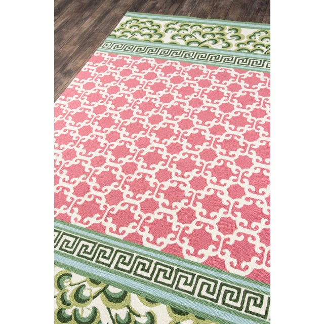 Geometric and floral patterns mix and match to create the charming design of this indoor/outdoor area rug. A central field...