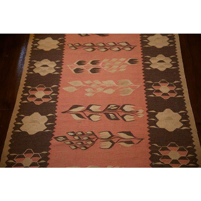19th Century Kilim runner from Bulgaria with leaves in the center ground and a border of stylized flowers. Lovely soft...