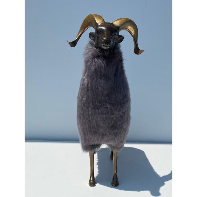 Brass sheep / ram sculpture in real sheep fur.
