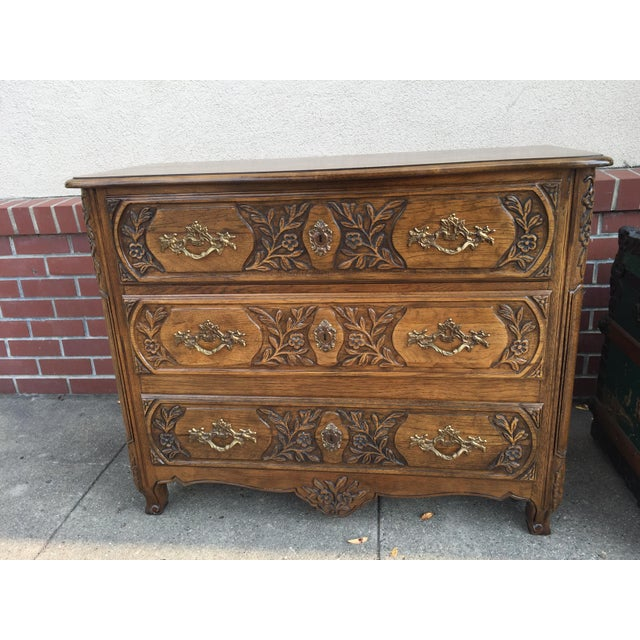 Baker furniture company French Country Commode with 3 drawers in excellent condition. Wonderful carving on the front, the...