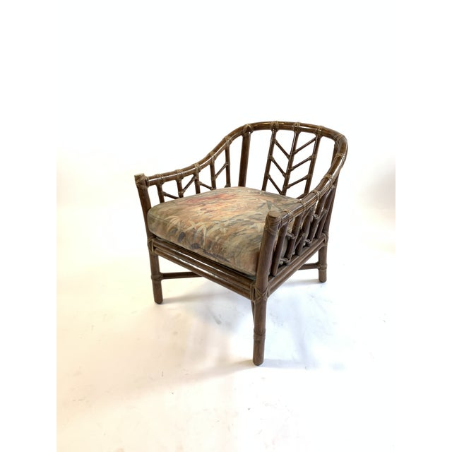 McGuire Rattan chair with linen upholstery in watercolor motif fabric upholstery. Perfect for the family room.