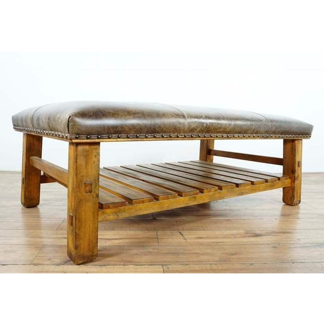 Bearing nailhead trim. With a slatted storage shelf underneath. Brand is Pottery Barn. Model is Caden. Dimensions (in):...