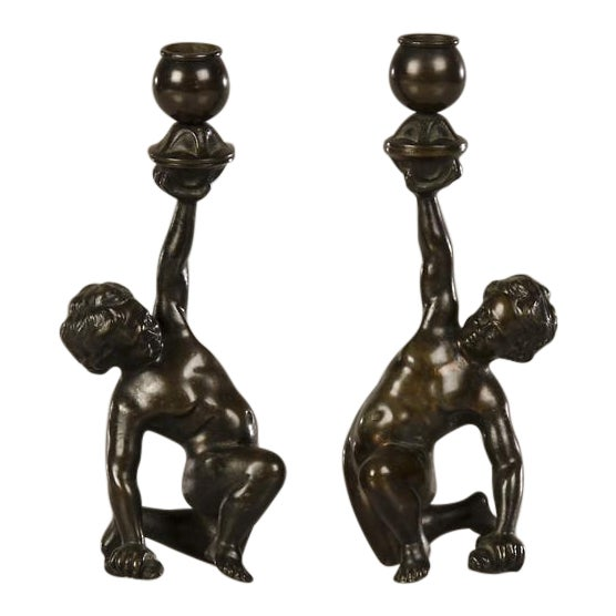 A pair of cast bronze candlesticks each featuring a kneeling putto from Italy c.1880 - Image 1 of 7