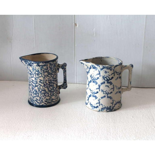 This group of sponge ware pitchers are in good condition with a minor hair line in the pitcher to the right. This size...