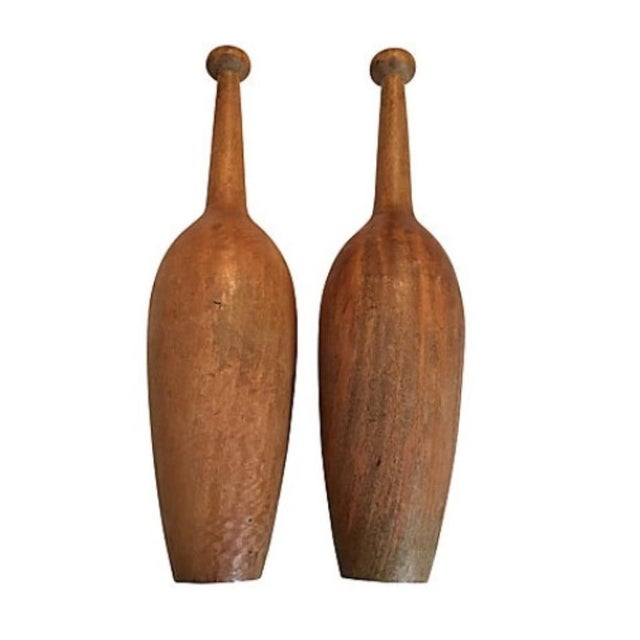 Pair of extra-large turned wood exercise clubs. No maker's mark. Wear consistent with age and use, surface wear, scratches.