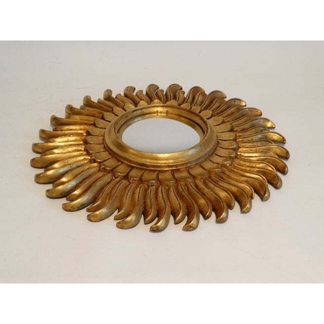 Vintage French sunburst mirror retaining the original convex mirrored glass. It has a lovely bright gilt finish and...