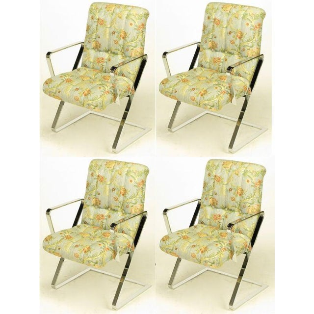 Set of four cantilevered, Z frame, chromed flat bar steel dining arm chairs. Original channeled and button tufted print...