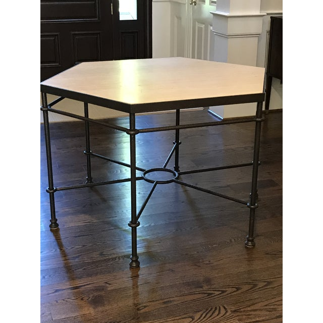A handmade Hexagonal center table in the style of Diego Giacometti, with an inset honed, open pore travertine top. Iron...