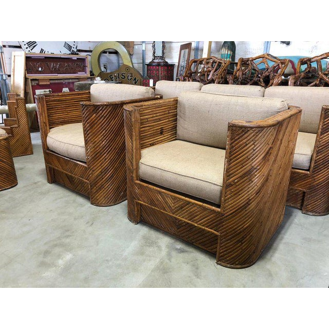 Mid-century Italian bamboo club chairs with new burlap upholstery.