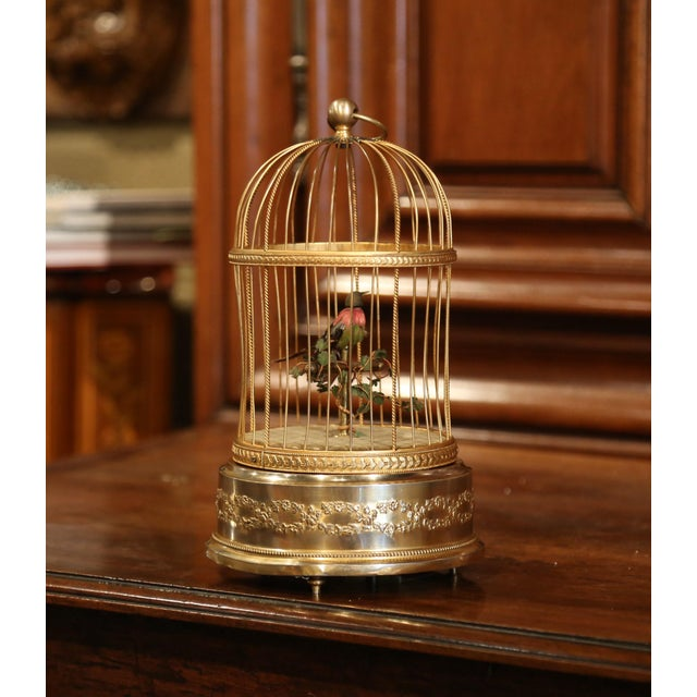 This antique birdcage was found in Paris; crafted circa 1890, the cage is rounded in shape with a dome. Inside it, a...
