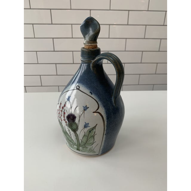 """This is a lovely vintage British jug hand painted with a thistle motif. 4""""W x 10""""L x 3""""D"""
