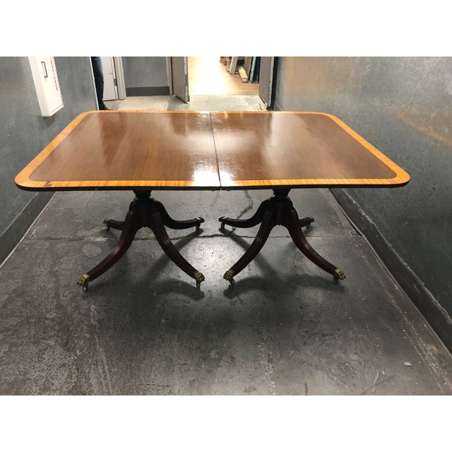 Design Plus Gallery presents a Queen Ann Style Double Pedestal Base Table. The table can be separated into two side...