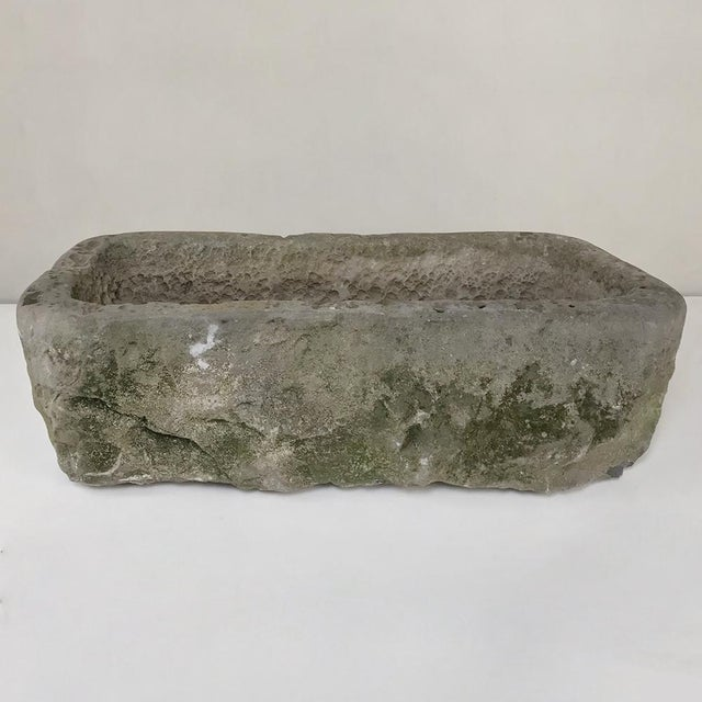 18th Century Hand-Carved Stone Jardiniere was sculpted from a solid block of limestone to provide the ideal addition for...