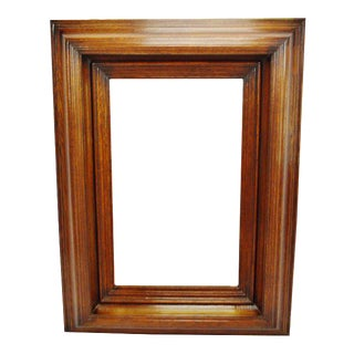 Large vintage wood framed beveled mirror. For Sale