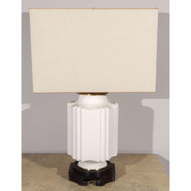Smaller Chinese chinoiserie style crackle glazed table lamp. Crackle glazed ceramic, wood base with Greek Key motif,...