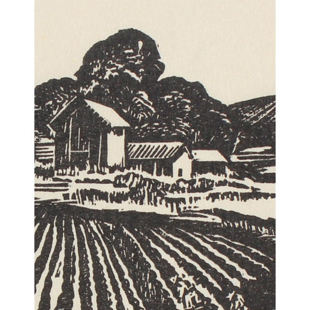 A monochromatic linoleum block print featuring a farm. Circa 1940s by San Leandro, CA artist Mary Watterick Evans. Evans...