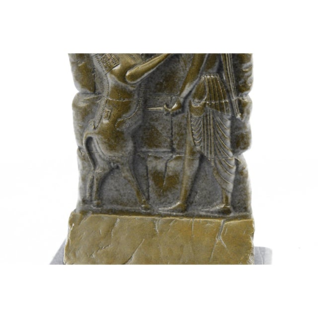 This is a wall relief of Darius I known as Darius The Great (550BC-486 BC). This sculpture was cast using the archaic...