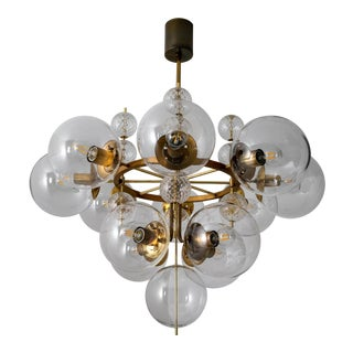 Mid 20th Century Hotel Chandelier With Brass Fixture and Hand-Blown Glass Globes For Sale