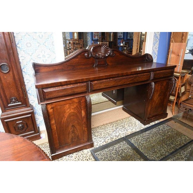 This is a superb mahogany pedestal server made in England Circa 1870. The condition is very good. The pedestal to the...