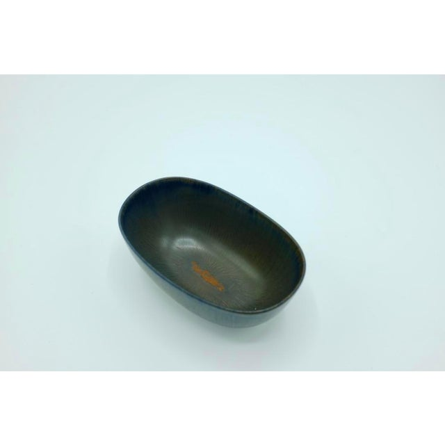 """Decorative black miniature ceramic bowl by Carl Harry Stålhane, marked """"CHS SYO"""" at the bottom. Small chip at the bottom..."""