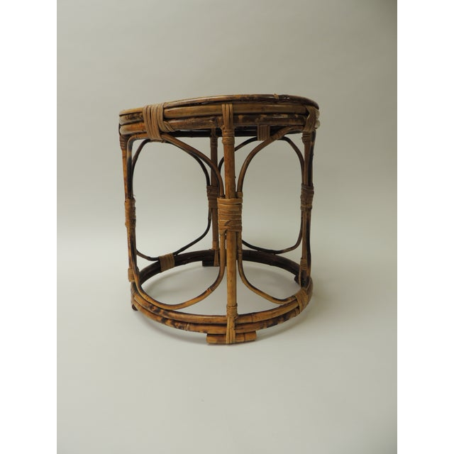 Vintage bamboo round side table Bamboo vintage round small side table with slatted bamboo top intertwined with rattan and...