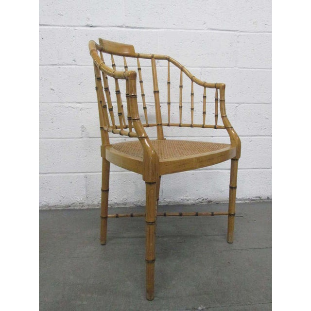 Pair Faux Bamboo Baker Chairs with caned seats.